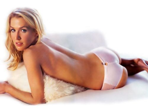 Poppy Montgomery in bed